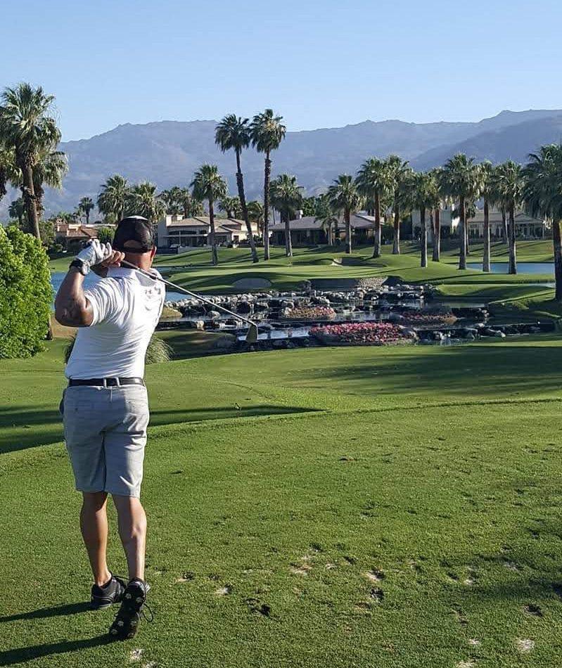 Scott playing golf